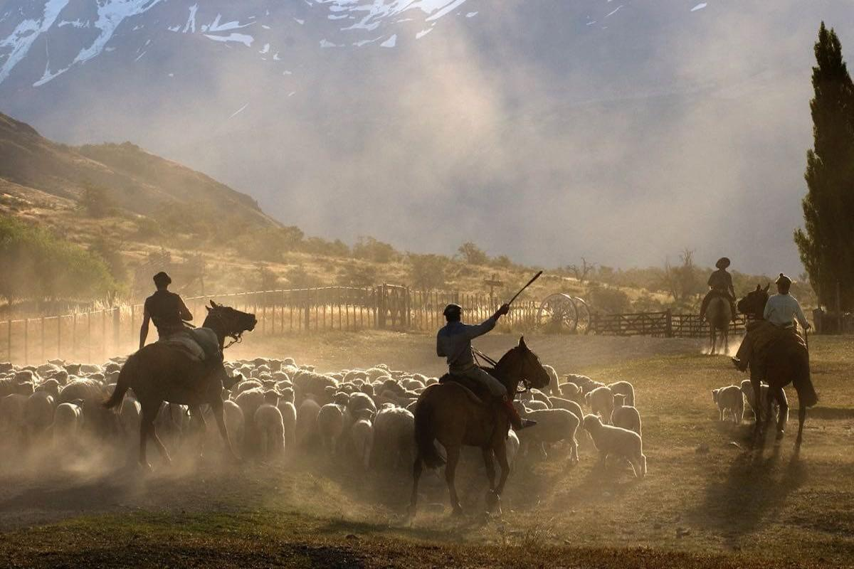 Gauchos riding Southern Patagonia