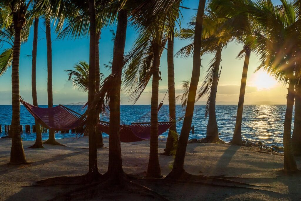 Thatch Caye, Belize - Hammocks on the Beach