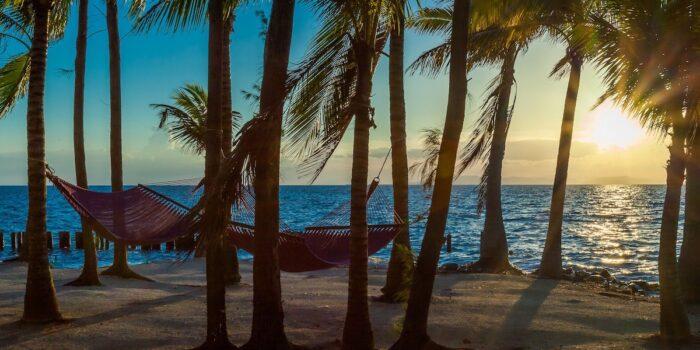 Thatch Caye, Belize - Hammocks on the Beach