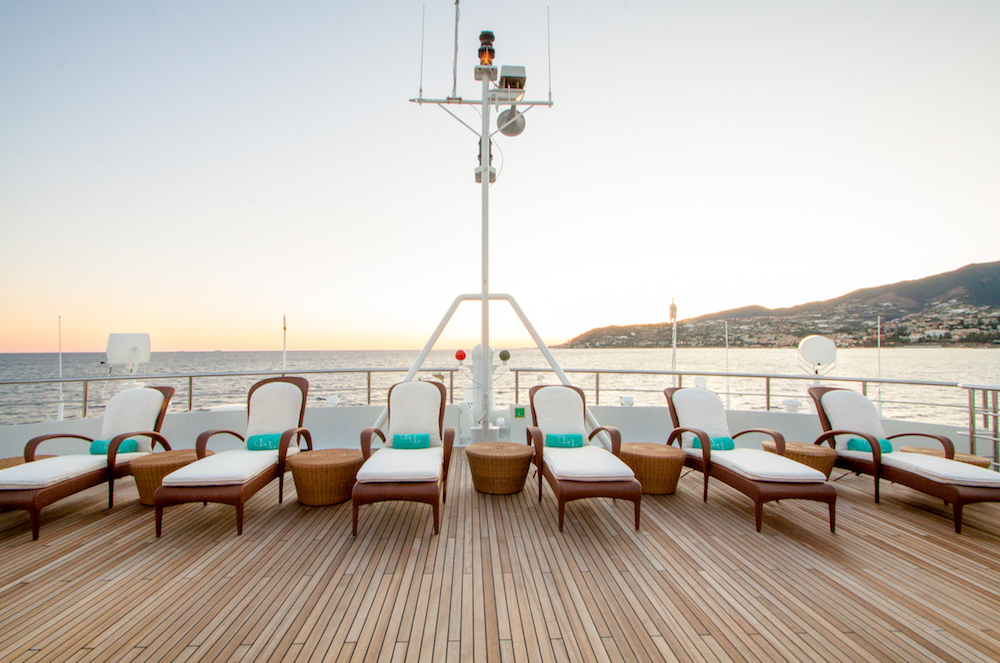 sunbathing superyacht aboard M/Y Legend
