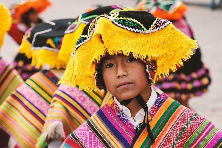 peru cusco boy colourful dress Plan South America